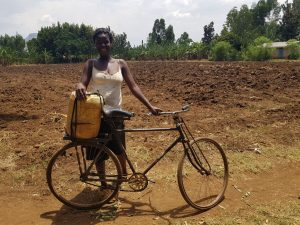 Community-woman-with-bike.-Bulambuli